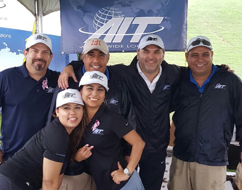 The team spirit at AIT-McAllen in Texas wasn't dampened by the rain when they sponsored a charity golf tournament in 2015.