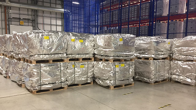 Pallets of finished pharmaceutical product wrapped in passive thermal covers